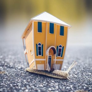 microphotography-of-orange-and-blue-house-miniature-on-brown-955793